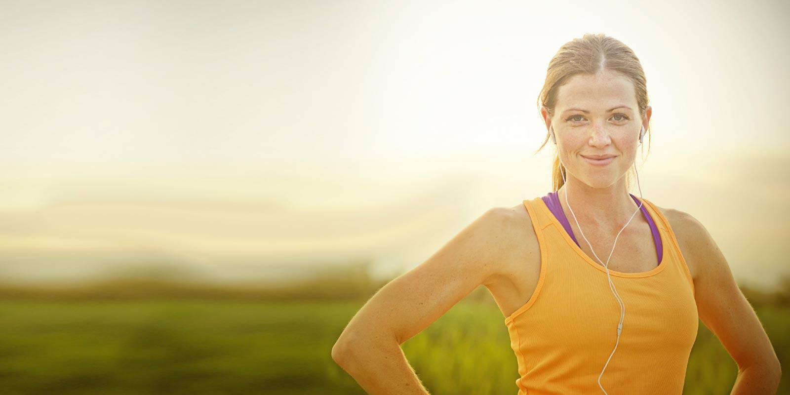 A happy female wearing sports gear